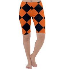 Harlequin Diamond Orange Black Cropped Leggings