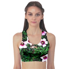 Pink Flowers Over A Green Grass Sports Bra
