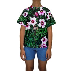 Pink Flowers Over A Green Grass Kids  Short Sleeve Swimwear