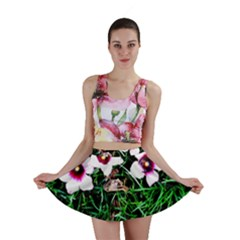 Pink Flowers Over A Green Grass Mini Skirt