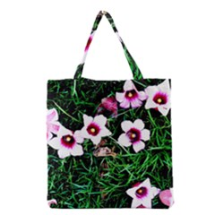 Pink Flowers Over A Green Grass Grocery Tote Bag by DanaeStudio