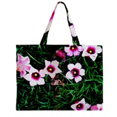 Pink Flowers Over A Green Grass Mini Tote Bag by DanaeStudio