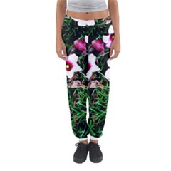 Pink Flowers Over A Green Grass Women s Jogger Sweatpants