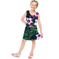 Pink Flowers Over A Green Grass Kids  Tunic Dress by DanaeStudio