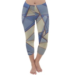 Blue And Tan Triangles Intertwine Together To Create An Abstract Background Capri Winter Leggings  by Simbadda
