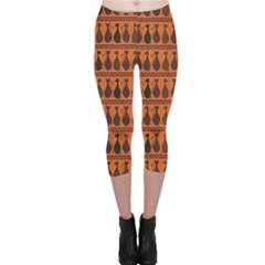 Brown Pattern Of Tribal Elegance African Cats Capri Leggings by CoolDesigns