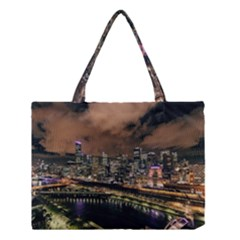 Cityscape Night Buildings Medium Tote Bag by Simbadda