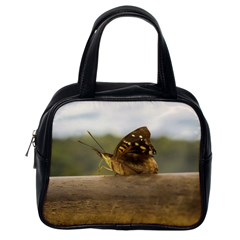 Butterfly Against Blur Background At Iguazu Park Classic Handbags (one Side) by dflcprints