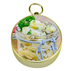 Potato salad in a jar on wooden Gold Compasses