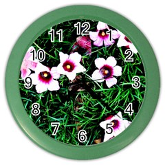 Pink Flowers Over A Green Grass Color Wall Clocks by DanaeStudio