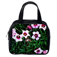 Pink Flowers Over A Green Grass Classic Handbags (one Side)