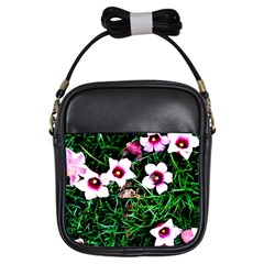 Pink Flowers Over A Green Grass Girls Sling Bags
