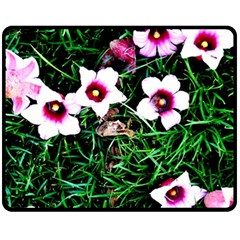 Pink Flowers Over A Green Grass Fleece Blanket (medium)  by DanaeStudio