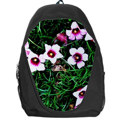 Pink Flowers Over A Green Grass Backpack Bag by DanaeStudio
