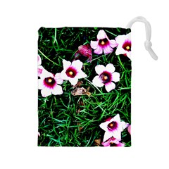 Pink Flowers Over A Green Grass Drawstring Pouches (large)