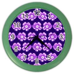 Purple Flower Pattern On Blue Color Wall Clocks by Costasonlineshop