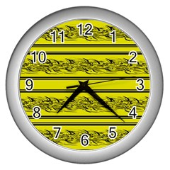 Yellow Barbwire Wall Clocks (silver)  by Valentinaart