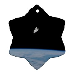 Astronaut Floating Above The Blue Planet Ornament (snowflake)