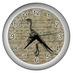 Dinosaur Skeleton Wall Clocks (silver)  by Valentinaart