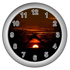 Sunset Sun Fireball Setting Sun Wall Clocks (silver)  by Simbadda