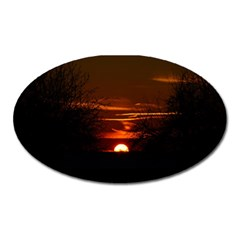 Sunset Sun Fireball Setting Sun Oval Magnet by Simbadda