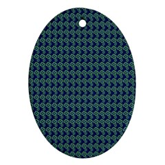 Clovers On Dark Blue Oval Ornament (two Sides) by PhotoNOLA