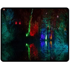 Illuminated Trees At Night Near Lake Fleece Blanket (medium)