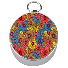 Background With Multi Color Floral Pattern Silver Compasses
