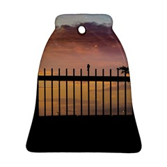 Small Bird Over Fence Backlight Sunset Scene Ornament (bell) by dflcprints