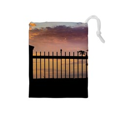 Small Bird Over Fence Backlight Sunset Scene Drawstring Pouches (medium)  by dflcprints