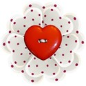 red spot flower heart button